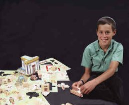 A boy building a Temple Model Kit