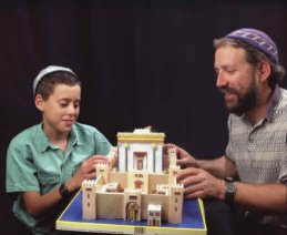 Father and son with completed Temple Model Kit